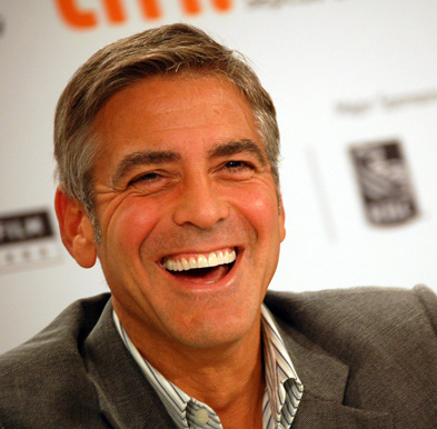 In this pic of George Clooney, he displays a genuine smile. Notice how